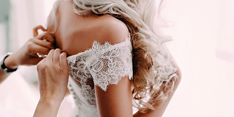 buttoning up brides dress