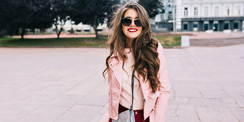 girl in pink jacket with curly hair
