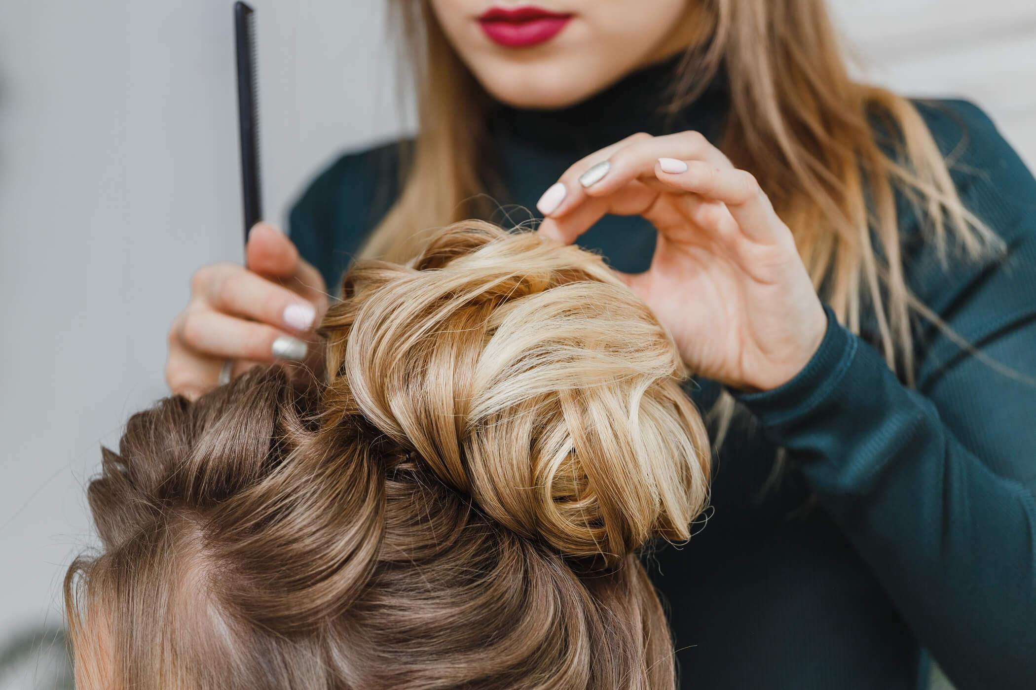 styling hair in messy bun